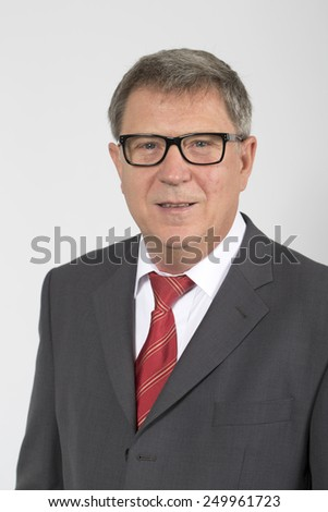 Portrait of serious smiling business man, isolated over white background - stock photo