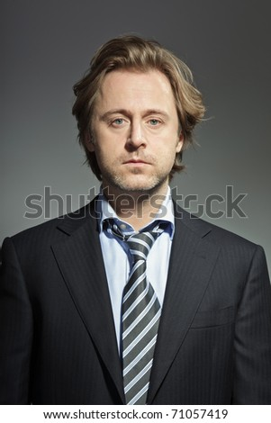Portrait of serious young business man. Studio photo. Thought. Thinking. In mind. Concentration. - stock photo
