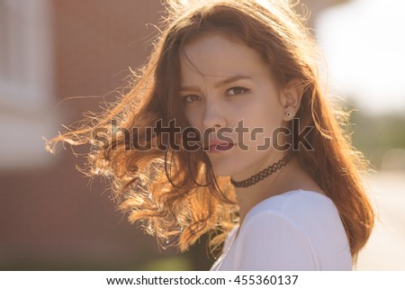 Portrait of serious young teenage woman student girl - stock photo