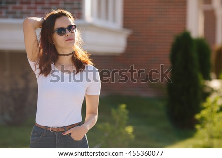 Portrait of serious young teenage woman student girl wearing sunglasses - stock photo