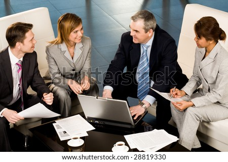 Portrait of several employees looking at their senior boss during teamwork - stock photo