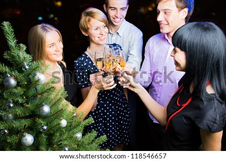 Portrait of several friends celebrating Christmas - stock photo