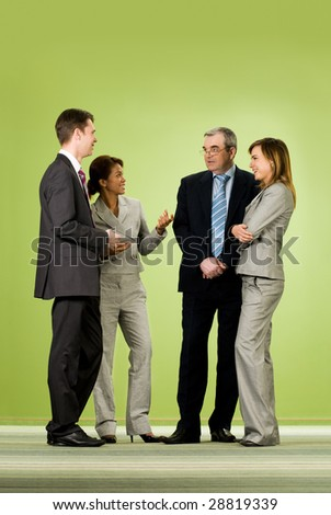 Portrait of several successful associates communicating with each other during break - stock photo