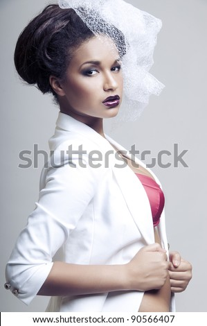 Portrait of Sexy african woman posing in white fop on light grey  background - stock photo