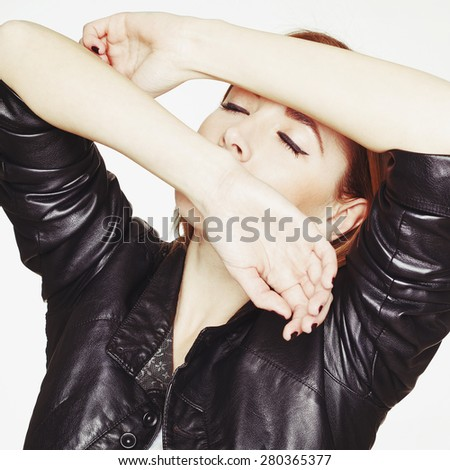 Portrait of sexy beautiful young blonde woman in leather jacket - stock photo