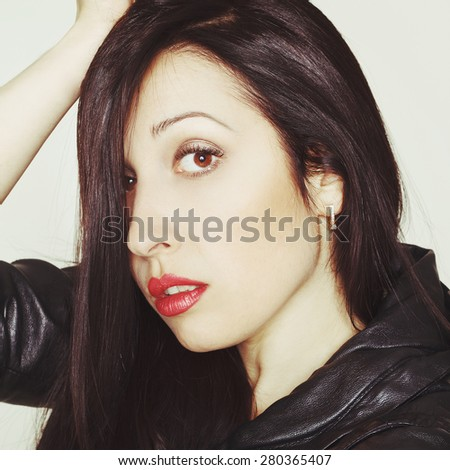 Portrait of sexy beautiful young brunette woman in leather jacket - stock photo
