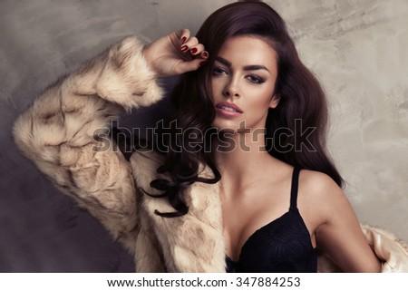 Portrait of sexy brunette woman wear fur  - stock photo