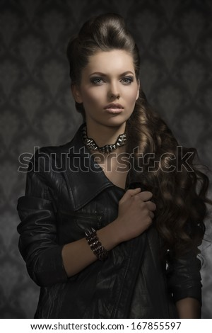 portrait of sexy fashion  girl with dark style, leather jacket, rock accessories and long brown hair  - stock photo