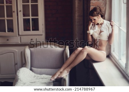 Portrait of sexy fashion model girl indoors. Beautiful lady in elegant white panties and bra. Beauty brunette woman with attractive buttocks in lace lingerie. Female ass in underwear. Naked body - stock photo