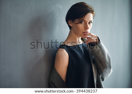 Portrait of sexy fashion woman on dark background - stock photo