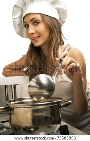 Portrait of sexy housewife tasting dish in kitchen room - stock photo