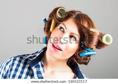 portrait of sexy housewife with curlers - stock photo