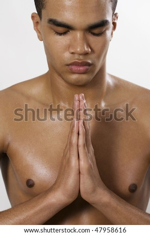 Portrait of sexy man meditating - stock photo