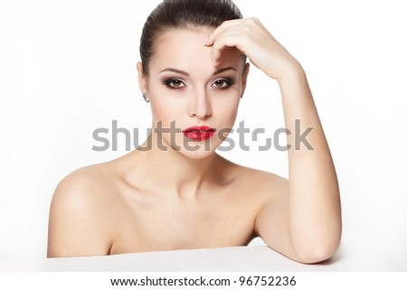 portrait of sexy sitting caucasian young woman model with glamour red lips,bright makeup, eye arrow makeup, purity complexion. Perfect clean skin - stock photo