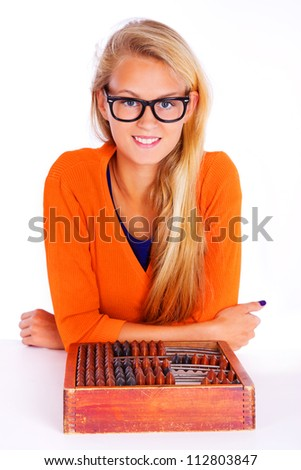 Portrait of sexy teacher posing in studio in glasses - stock photo