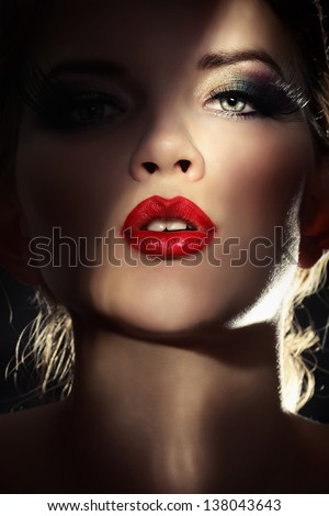 Portrait of sexy woman in darkness - stock photo