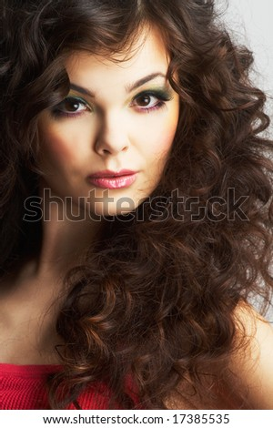 Portrait of sexy woman with beautiful make-up and long curly hair - stock photo