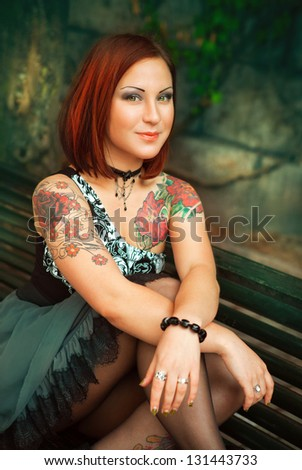 portrait of sexy woman with tattoo on her arms. tattoo - stock photo