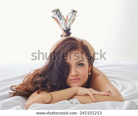 Portrait of sexy young woman posing at camera - stock photo