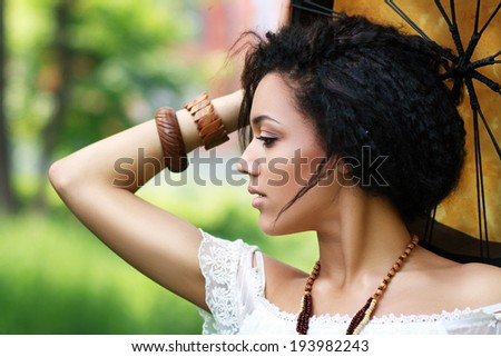 Portrait of shaman woman with a tambourine close up - stock photo