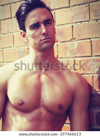 portrait of shirtless man outdoors - stock photo