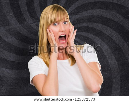 Portrait Of Shocked Woman against an abstract background - stock photo