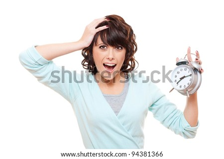 portrait of shocked woman with alarm clock over white background - stock photo