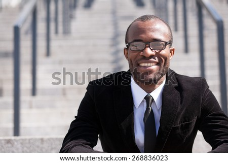 portrait of sitting employee black man - stock photo