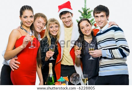 Portrait of six friends hugging on the background of christmas tree - stock photo