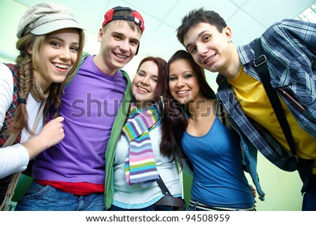 Portrait of six smiling students together - stock photo