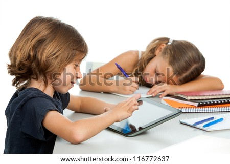 Portrait of small boy doing homework on tablet.Isolated - stock photo