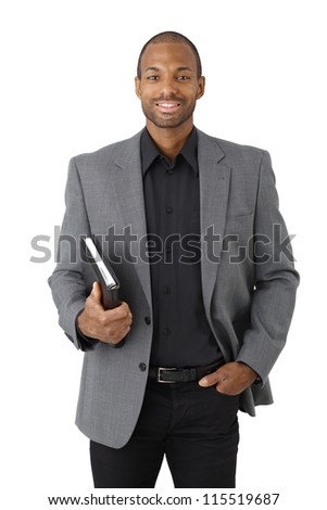 Portrait of smart black businessman smiling with personal organizer handheld, isolated on white. - stock photo