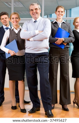 Portrait of smart business people standing next to each other and looking at camera - stock photo