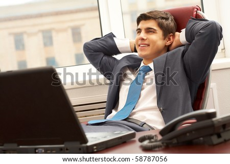 Portrait of smart businessman thinking about something with smile in office - stock photo