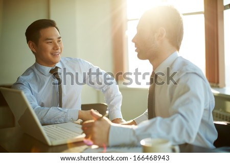Portrait of smart businessmen discussing new ideas at meeting - stock photo
