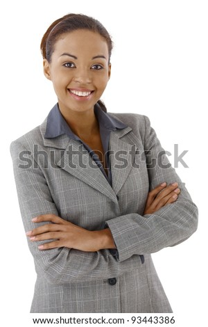 Portrait of smart businesswoman smiling with arms crossed.? - stock photo
