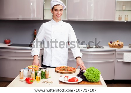 Portrait of smart chef preparing delicious meal for customer - stock photo