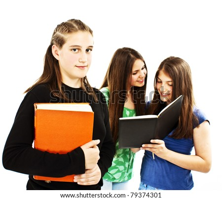 Portrait of smart student girl with the classmates on the background - stock photo