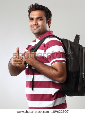 portrait of smiley student showing thumbs - stock photo