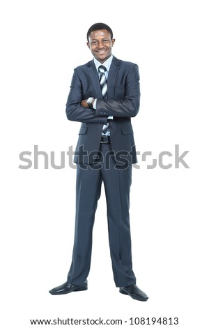 Portrait of smiling African American business man standing over white background - stock photo