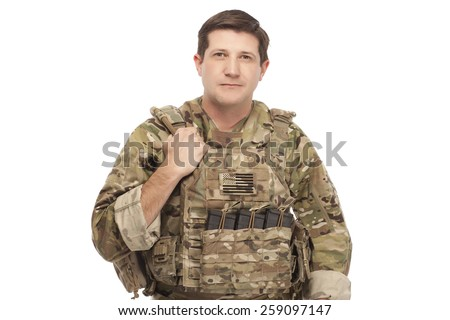 Portrait of smiling army soldier against white background - stock photo