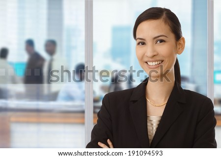 Portrait of smiling asian businesswoman in office. - stock photo