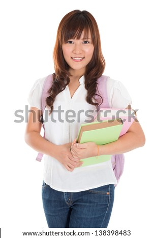 Portrait of smiling Asian female college student isolated on white background - stock photo