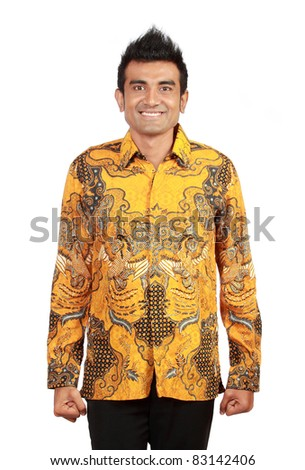 Portrait of smiling asian man wearing batik - stock photo