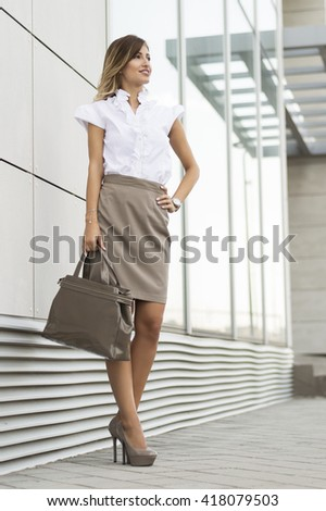 Portrait of smiling attractive confident young business woman  - stock photo
