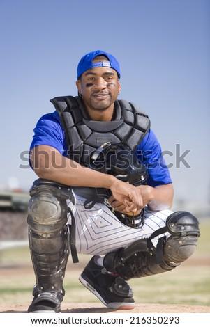 Portrait of smiling baseball catcher - stock photo