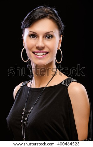 Portrait of smiling beautiful woman, isolated on black background. - stock photo
