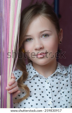 Portrait of smiling beautiful young woman - stock photo