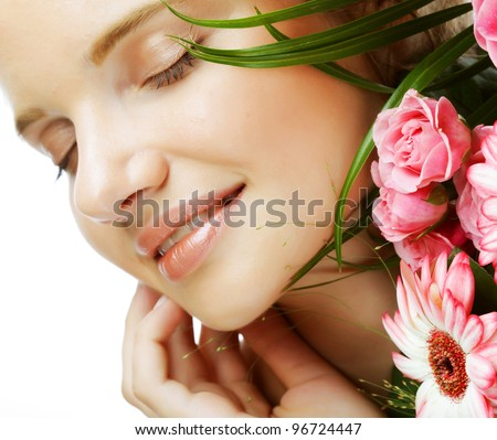 Portrait of  smiling beautiful young woman with bouquet flowers - stock photo