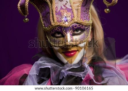 Portrait of smiling beauty woman in venetian mask - stock photo